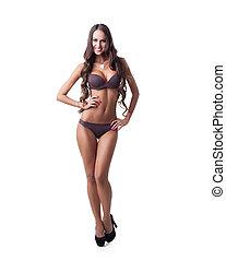 Happy tanned model posing in underwear