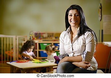 happy teacher with children eating in kindergarten -...