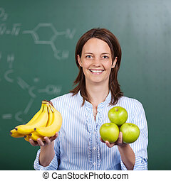 Happy teacher with fresh fruit