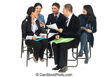 Happy team having conversation at seminar - Happy team of...