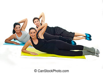 Happy team of fitness people doing exercises