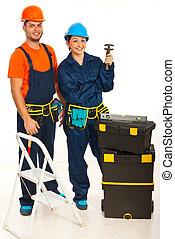 Happy team of plumbers