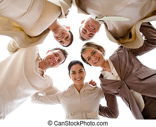 Happy Team - Small group of business people standing in...