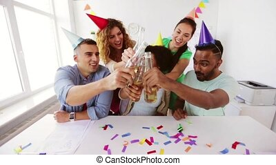 happy team with drinks celebrating at office party -...