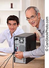 Happy technician fixing a computer