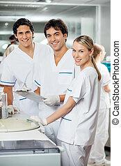 Happy Technicians In Laboratory