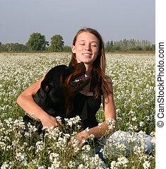 happy teen and dog