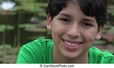 Happy Teen Boy Posing at Pond