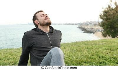 Happy teen breathing fresh air sitting outdoors - Happy teen...
