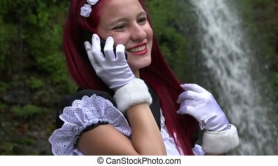 Happy Teen Cosplay Girl Talking On Cell Phone