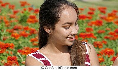 Happy Teen Girl In Flower Garden