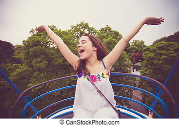 girl on panoramic wheel