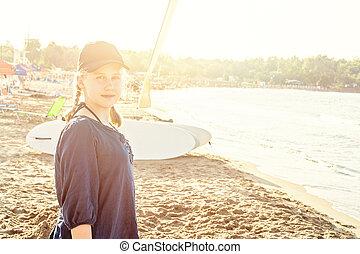 Happy teen girl on sea beach, Greece