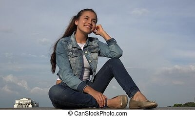 Happy Teen Girl Sitting Relaxing And Daydreaming