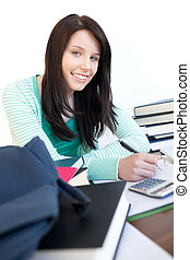 Happy teen girl studying on a desk