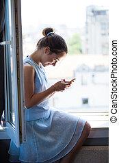 happy teen girl with smart phone