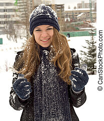 Happy teen girl with snow - beautifull happy teen girl with...