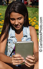 Happy Teen Girl With Tablet