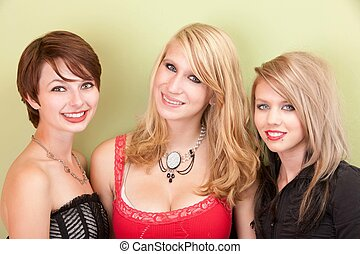 Happy teen girls smile for the camera