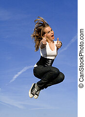 happy teen jumping, thumbs up