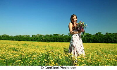 Happy teen laughs with flowers look