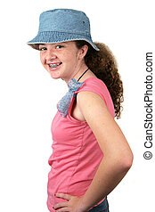 Happy Teen Model - A stylish teenaged girl smiling with...
