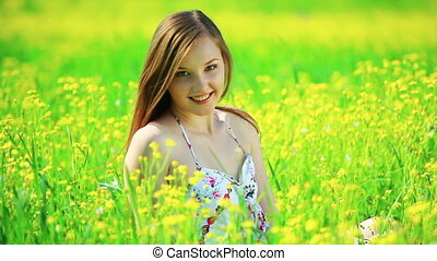 Happy teen on the meadow