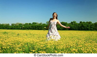 Happy teen spinning in the meadow