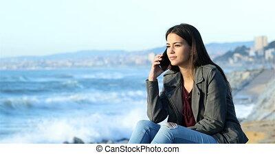 Happy teen talking on phone on the beach - Happy teen...