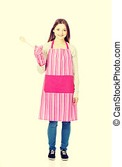 Happy teen woman wearing kitchen apron.