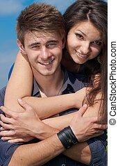 Happy teenage couple embracing
