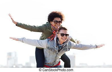 happy teenage couple in shades having fun outdoors -...