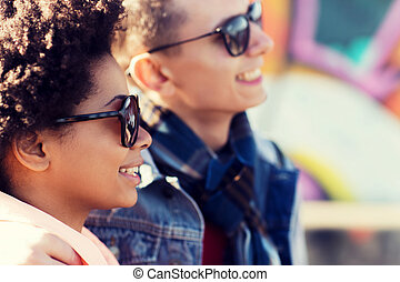 happy teenage friends in shades outdoors - friendship, ...