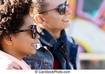 happy teenage friends in shades outdoors