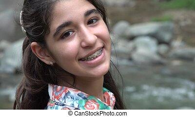 Happy Teenage Girl at River