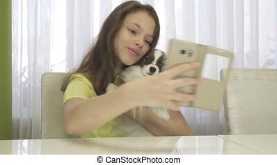 Happy teenage girl doing selfie with her dog stock footage video