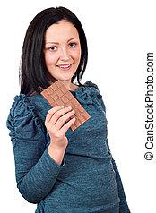 happy teenage girl eating chocolate