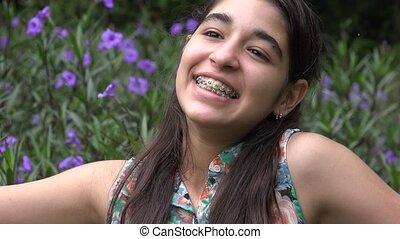 Happy Teenage Girl in Flower Garden
