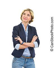 Happy teenage girl looking on copy space