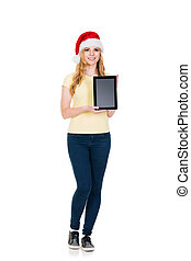 Happy teenage girl posing in a Christmas hat on white