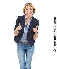 Happy teenage girl showing thumbs up