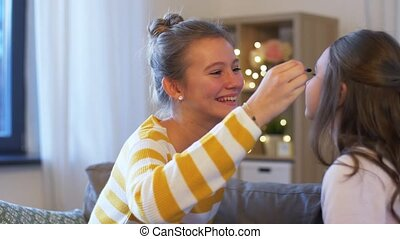 happy teenage girls doing make up at home - people, ...