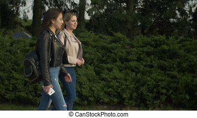 Happy teenage girls enjoying nature in parkland - Positive...