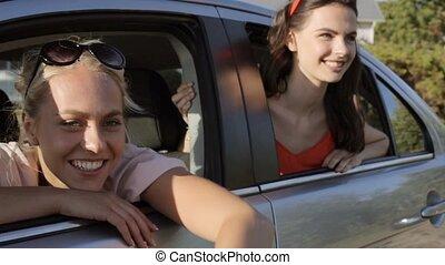 happy teenage girls or women in car at seaside 29 - summer...