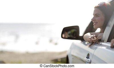 happy teenage girls or women in car at seaside 3 - summer...