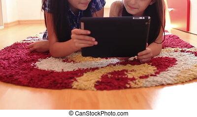 happy teenage girls using tablet pc
