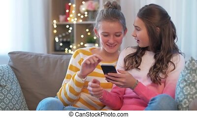 happy teenage girls with smartphone at home - people, ...