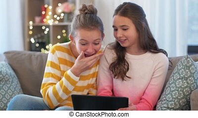 happy teenage girls with tablet computer at home - people, ...
