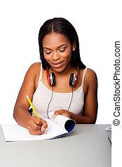 Happy teenage student doing homework