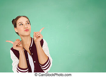 happy teenage student girl over green school board